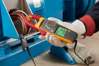 The Fluke 378 FC Clamp Meter measuring Amps AC and Volts AC
